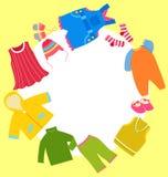 Vestiti del bambino impostati e blocco per grafici Fotografia Stock