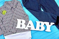 Vestiti del neonato per usura di autunno Fotografia Stock
