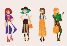 Vestiti di via casuali assorbiti ragazze adorabili dei pantaloni a vita bassa dell'insieme giovani nei colori luminosi Raccolta c illustrazione di stock