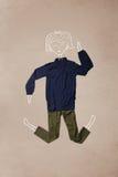 Vestiti disposti nell'azione con il disegno della donna Fotografia Stock Libera da Diritti