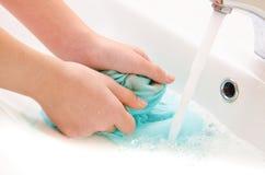 Vestiti per lavarsi le mani Immagine Stock