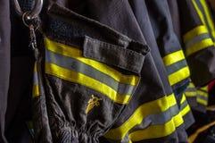 Vestiti a prova di fuoco Fotografie Stock Libere da Diritti