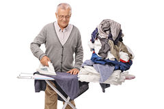 Vestiti rivestenti di ferro senior allegri Fotografia Stock