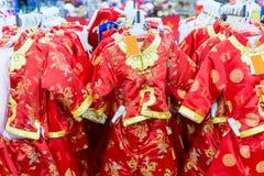 Vestiti tradizionali cinesi per i bambini Fotografia Stock