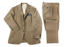 Vestito beige con i pantaloni ed il rivestimento ordinatamente piegati Immagine Stock Libera da Diritti