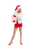 Vestito come Santa Claus Pointing Advertising Space fotografia stock