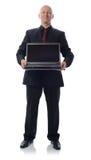 Vestito con il computer portatile Fotografia Stock