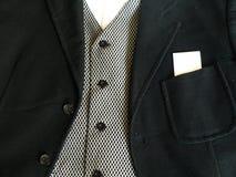 Vestito con la scheda in bianco Fotografia Stock