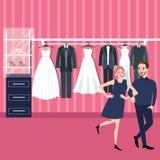 Vestito da sposa scelto dalla donna dell'uomo delle coppie in deposito nuziale Fotografie Stock Libere da Diritti