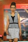 Vestito dalla sfilata di moda retro Fotografia Stock