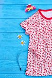 Vestito ed accessori dalla ragazza del bambino Immagini Stock