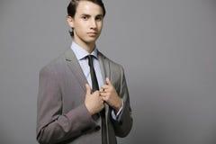 Vestito grigio. Fotografia Stock