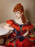 Vestito rosso dalla ragazza Fotografia Stock