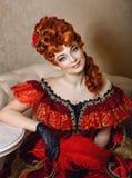 Vestito rosso dalla ragazza Immagine Stock