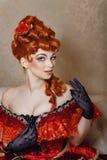 Vestito rosso dalla ragazza Fotografie Stock