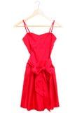 Vestito rosso sul gancio isolato Fotografia Stock Libera da Diritti