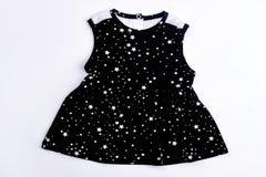 Vestito stampato il nero dalla neonata Fotografia Stock