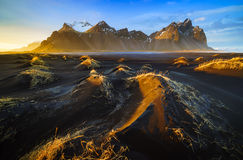 Vestrahorn mountain with black volcanic lava sand dunes at sunse Stock Image