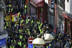 `Vests Yellow` protesters marching. royalty free stock photo