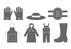 Vestuário de proteção para trabalhar no jardim Ícones do preto liso, objetos da roupa de trabalho Imagens de Stock