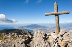 The vesuvio and the cross. The picture shows Vesuvius and the whole Neapolitan gulf preceded by a cross set on the molar peak overlooking the entire city of Royalty Free Stock Photo