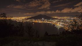 The night of the vesuvio. The vesuvio photographed at night illuminated by all the lights of the city and the gulf of naples with the well-defined shadow of the Royalty Free Stock Image