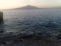 The Vesuvio seen from the Sorrento Peninsula-2. The Vesuvio seen from the Sorrento Peninsula,at sunset, only the blue sea separates from the still active volcano royalty free stock images