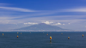 Vesuvius, looking from Sorrento. A view from Sorrento of the active volcano, Vesuvius with calm seas and marker buoys in the foreground Stock Photos