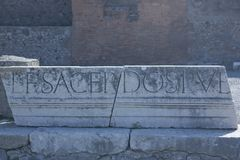 The bas-relief with the word Pompeii Italy Stock Photos