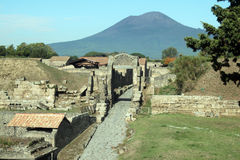 Vesuvius over pompeii. The roman ruins of pompeii and the vesuvius royalty free stock photos