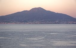Vesuvius with part of the coast and the Gulf of Naples photographed by the Sorrento coast at sunset. In a beautifull day Royalty Free Stock Photography
