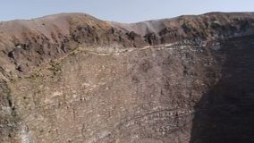Vesuvius with rocky slopes and cauldron-like crater shown from above, sequence. Stock footage stock video