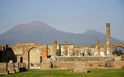 Vesuvius and ruins. Vesuvius Volcano onimously overlooking the ruins of Pompeii which was buried in AD79 by an eruption royalty free stock images