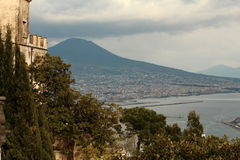 Vesuvius seen from castle in Napoli. Vesuvius seen from the terrace of the national museum of San Martino. Low clouds were sitting right over the volcano Stock Photo