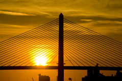Vet Bridge Sunrise 2. Sunrise Veteran's Glass City Skyway over Maumee River in Toledo, OH Stock Photo