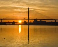 Vet Bridge Sunrise. Sunrise Veteran's Glass City Skyway over Maumee River in Toledo, OH Stock Photos