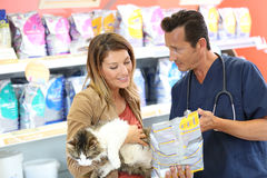 Vet giving advice about the food for pets Royalty Free Stock Photo