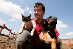 Vet holding dog and cat Royalty Free Stock Images