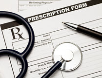 Vet Rx. Blank veterinarian prescription form with stethoscope and pen Stock Image