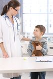 Vet and smiling kid with pet rabbit Stock Photo