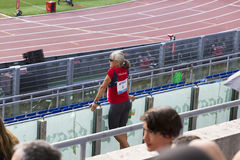 Veteran athlet. Watching a race on Diamond League in Rome, Italy in 2016 stock photos