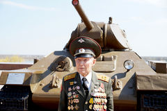Veteran of the Battle of Stalingrad colonel Vladimir Turov. Defender of Stalingrad veteran of World War II colonel Vladimir Semenovich Turov at the T-34 tank royalty free stock image