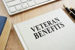 Veteran Benefits on a desk. Book about Veteran Benefits on a desk royalty free stock images