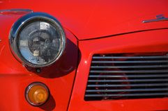 Veteran car. Detail of a shiny red veteran car on sunny day Stock Image