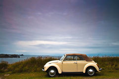 Veteran car on a french beach Royalty Free Stock Photo