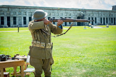 Veteran demostrating vintage assult rifle from WWII Royalty Free Stock Image