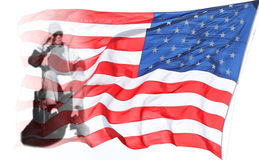 Veteran. Disabled American veteran is saluting in front of US flag royalty free stock photo