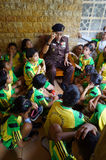 Veteran. Elementary students listen to the story of the war of independence of a veteran in the city of Solo, Central Java, Indonesia Royalty Free Stock Images
