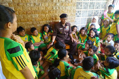 Veteran. Elementary students listen to the story of the war of independence of a veteran in the city of Solo, Central Java, Indonesia Stock Images