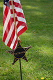 Veteran flag. With star gravesite marker Royalty Free Stock Photo
